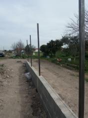 Muro e barras da vedação